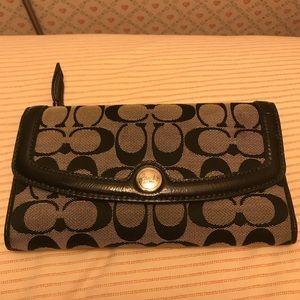 Black and grey coach wallet